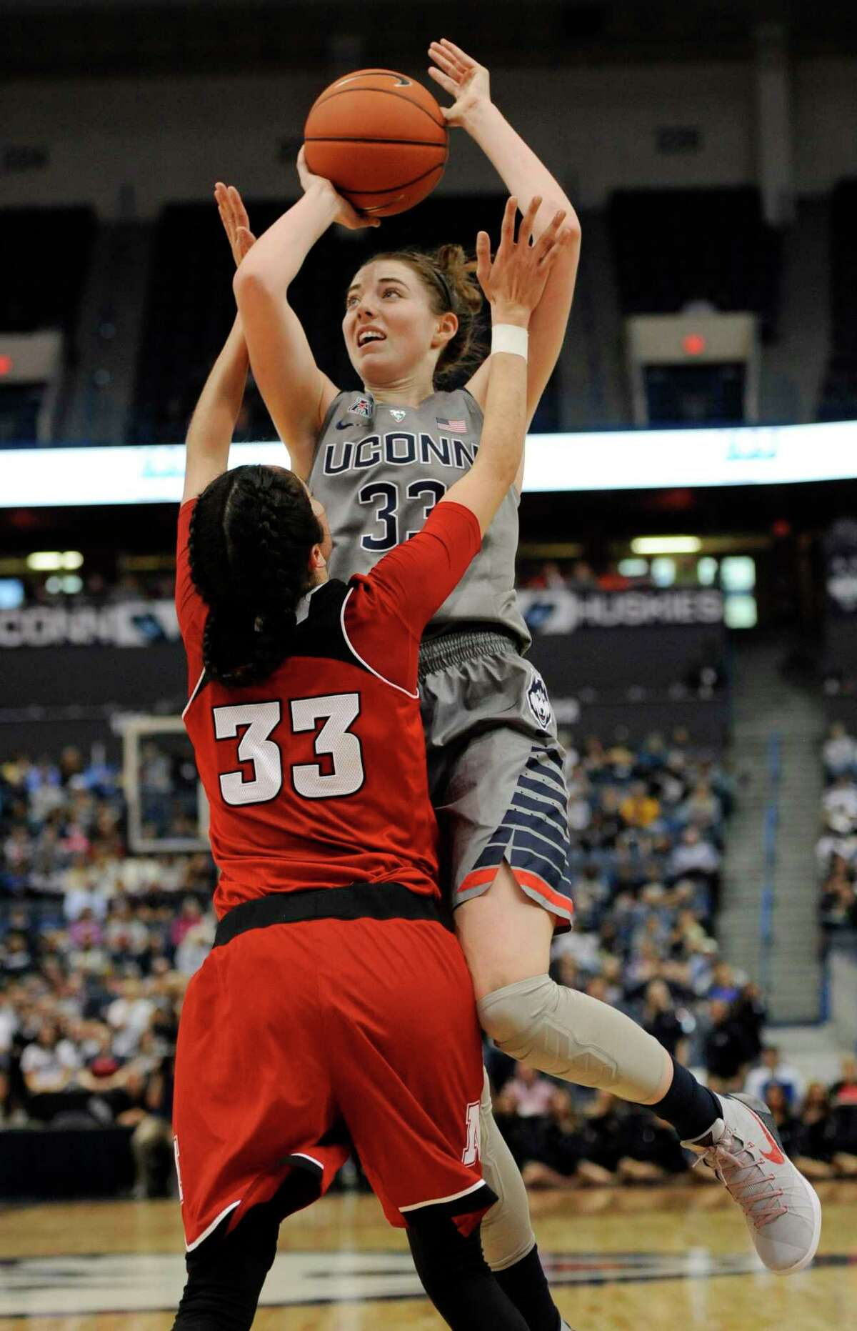UConn's Katie Lou Samuelson goes up for a basket against Nebraska's Rachel Theriot, left, during the second half on Stuarday.