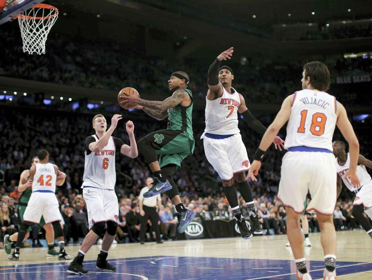 Celtics guard Isaiah Thomas drives through the Knicks defense during the third quarter Tuesday in New York. The Celtics won 97-89.