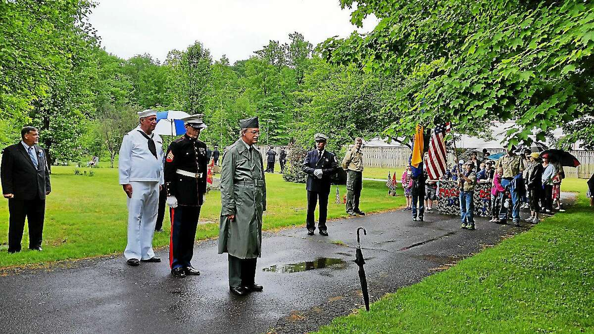 Veterans Steve Williams of the U.S. Navy; Randy Minervino of the U.S. Marines; and Michael Smart, of the U.S. Army, all from Northfield, honor fallen soldiers on Sunday morning at the Northfield Cemetery where the Northfield Memorial Day Ceremony and Parade culminated.