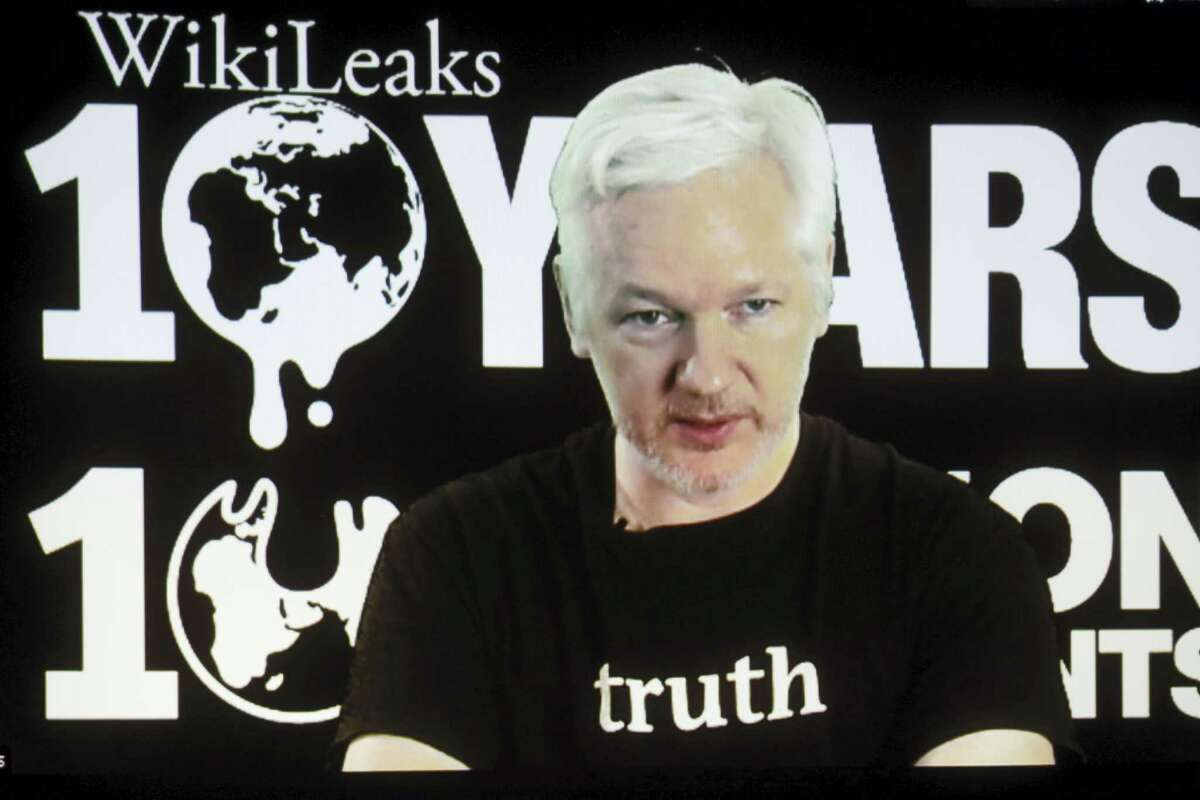 FILE - In this Oct. 4, 2016 file photo, WikiLeaks founder Julian Assange participates via video link at a news conference marking the 10th anniversary of the secrecy-spilling group in Berlin. WikiLeaks said on Monday, Oct. 17, 2016, that Assange's internet access has been cut by an unidentified state actor.