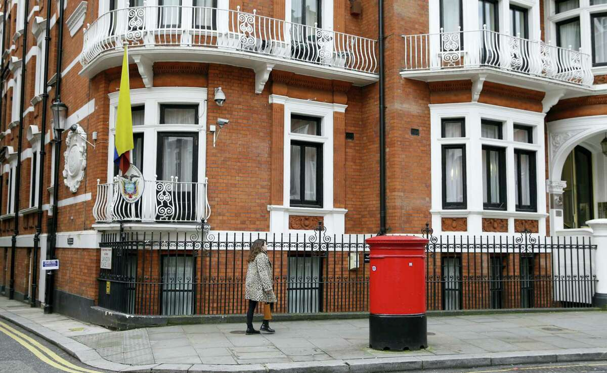 A woman walks past the Ecuadorian Embassy in London, Tuesday, Oct. 18, 2016. Midway through releasing a series of damaging disclosures about U.S. presidential contender Hillary Clinton, WikiLeaks founder Julian Assange says his hosts at the Ecuadorean Embassy in London abruptly cut him off from the internet. The news adds another layer of intrigue to an extraordinary campaign.