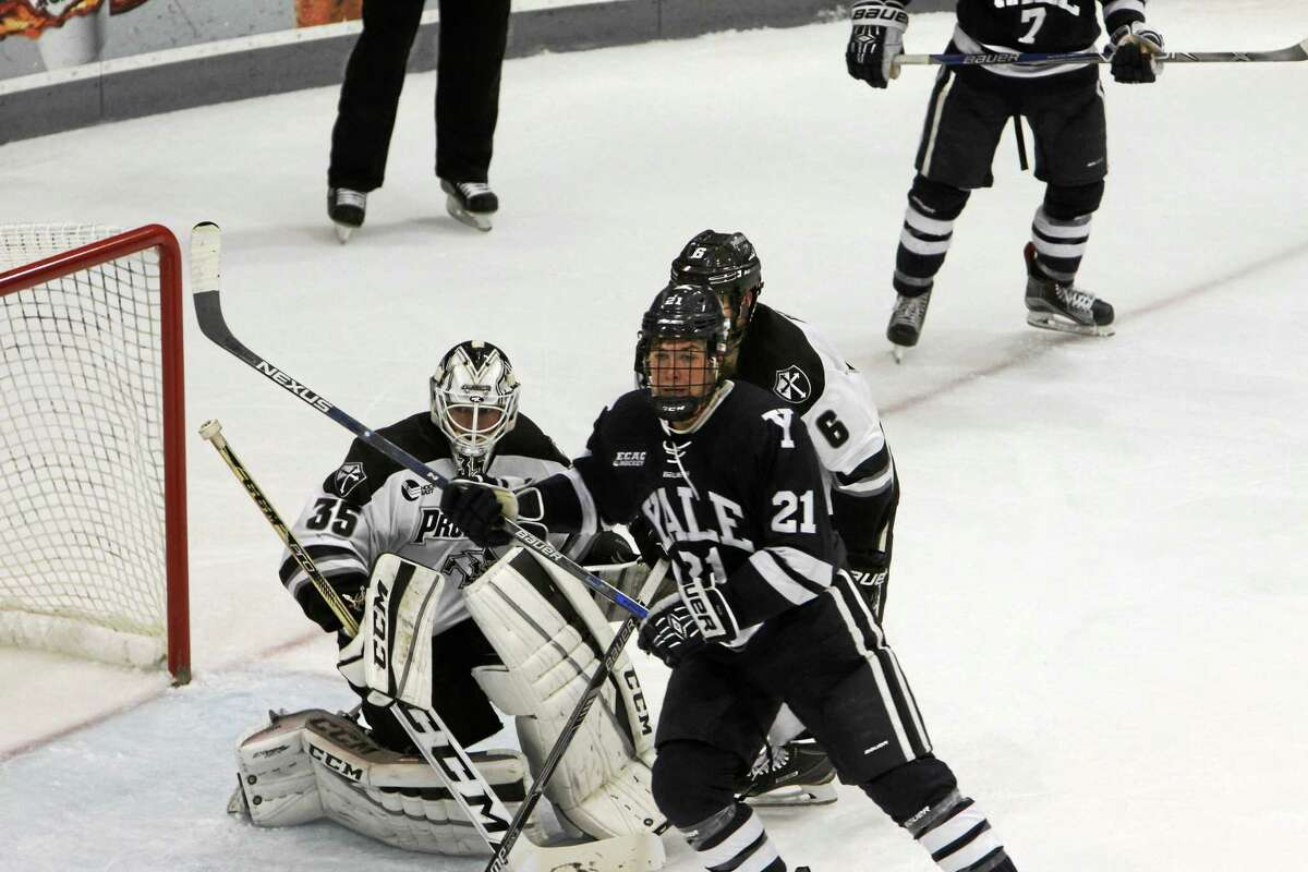 Yale's John Hayden camps out in front of the net during Saturday's game against Providence.