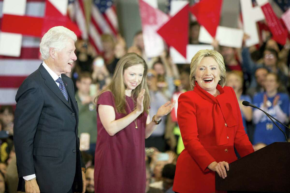 Democratic presidential candidate Hillary Clinton, accompanied by former President Bill Clinton and their daughter Chelsea Clinton, arrives at her caucus night rally at Drake University in Des Moines, Iowa, Monday.