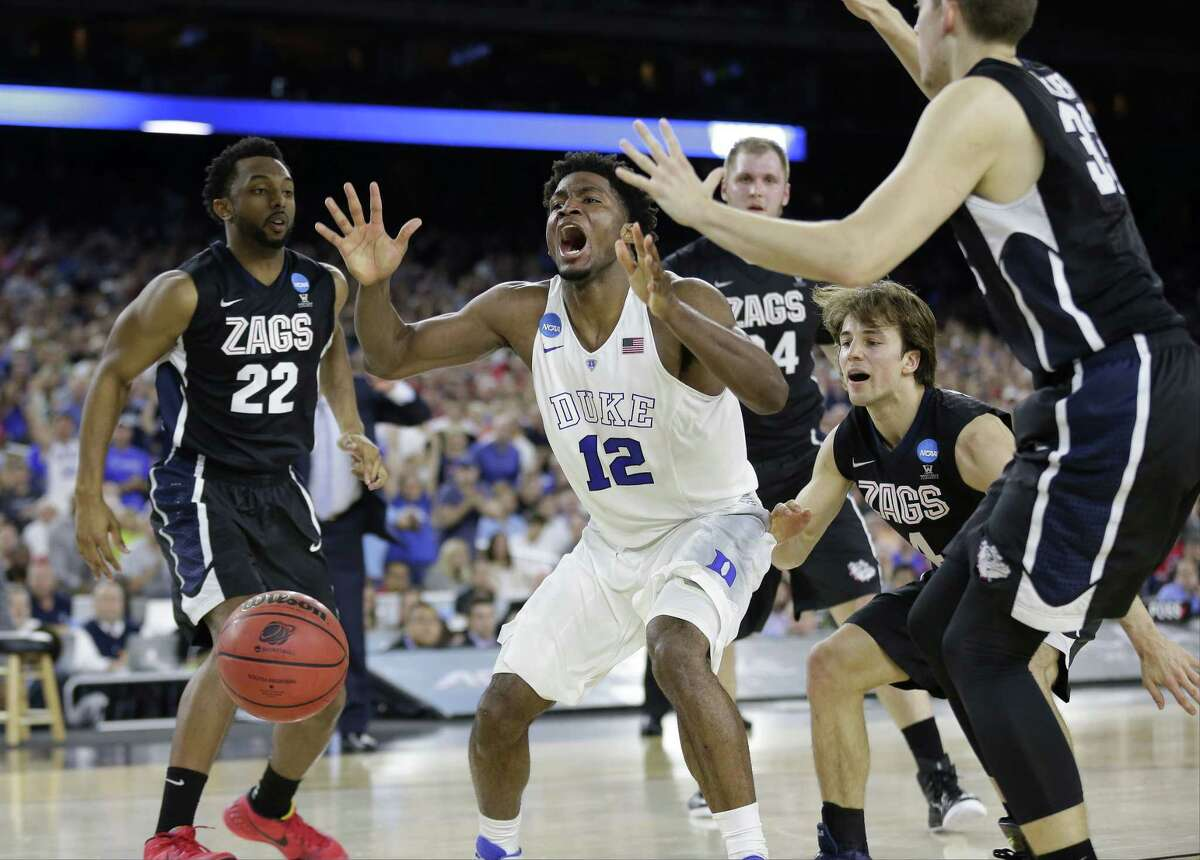 Duke's Justise Winslow has the ball knocked away against Gonzaga during the second half of a college basketball regional final game in the NCAA Tournament Sunday, March 29, 2015, in Houston. (AP Photo/Charlie Riedel)