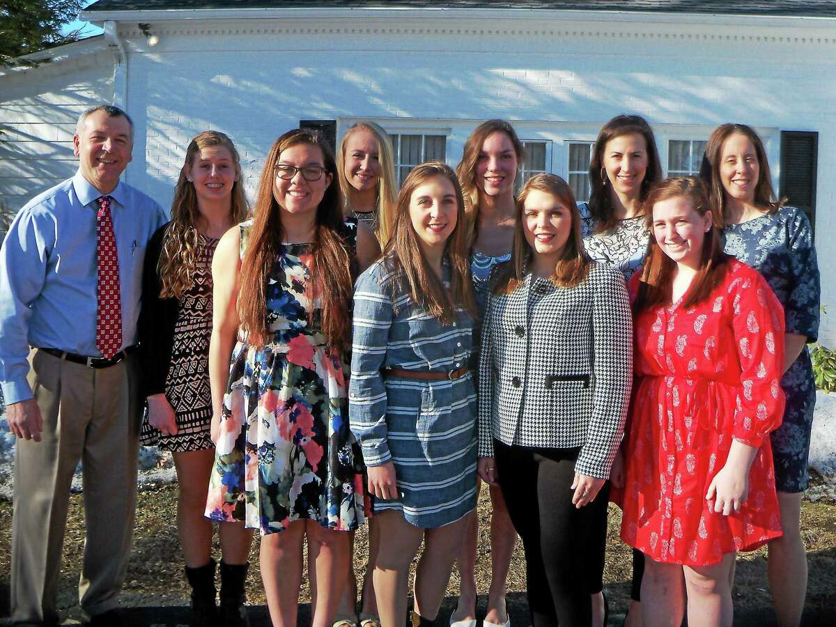 Torrington girls basketball pose for a photo Sunday night at PSam's Restaurant. Pictured front row from left: Kendra Covington, Shelby Howe, Taylor Howe, Abbi Fisher. Back row from left: Head Coach Mike Fritch, Brittany Anderson, Paige Middleton, Mia Barbieri, Coach Erika Pratt, Coach Barbara Beebe.