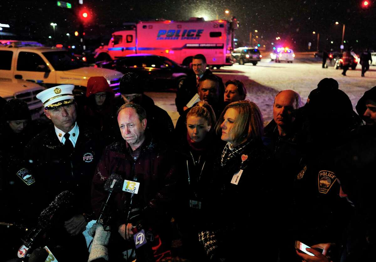 Colorado Springs, Colo., Mayor John Suthers, second from left, talks to media after a deadly shooting at a Planned Parenthood clinic Friday, Nov. 27, 2015, in Colorado Springs, Colo.