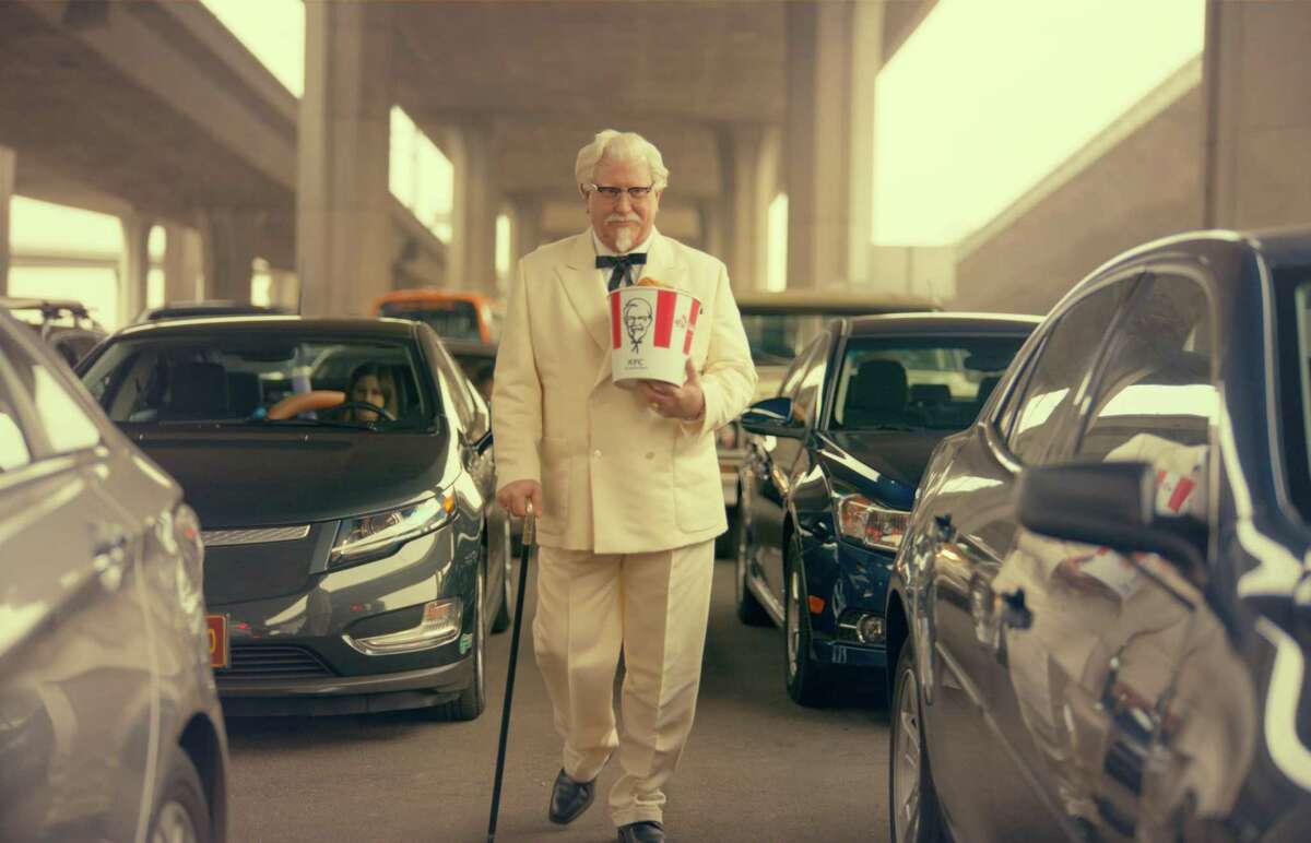 """This image provided by Yum Brands shows """"Saturday Night Live"""" alum Darrell Hammond as Colonel Sanders in a new KFC television ad. The real Col. Harland Sanders died nearly 35 years ago, and KFC hasn't featured him in TV ads for about 20 years."""