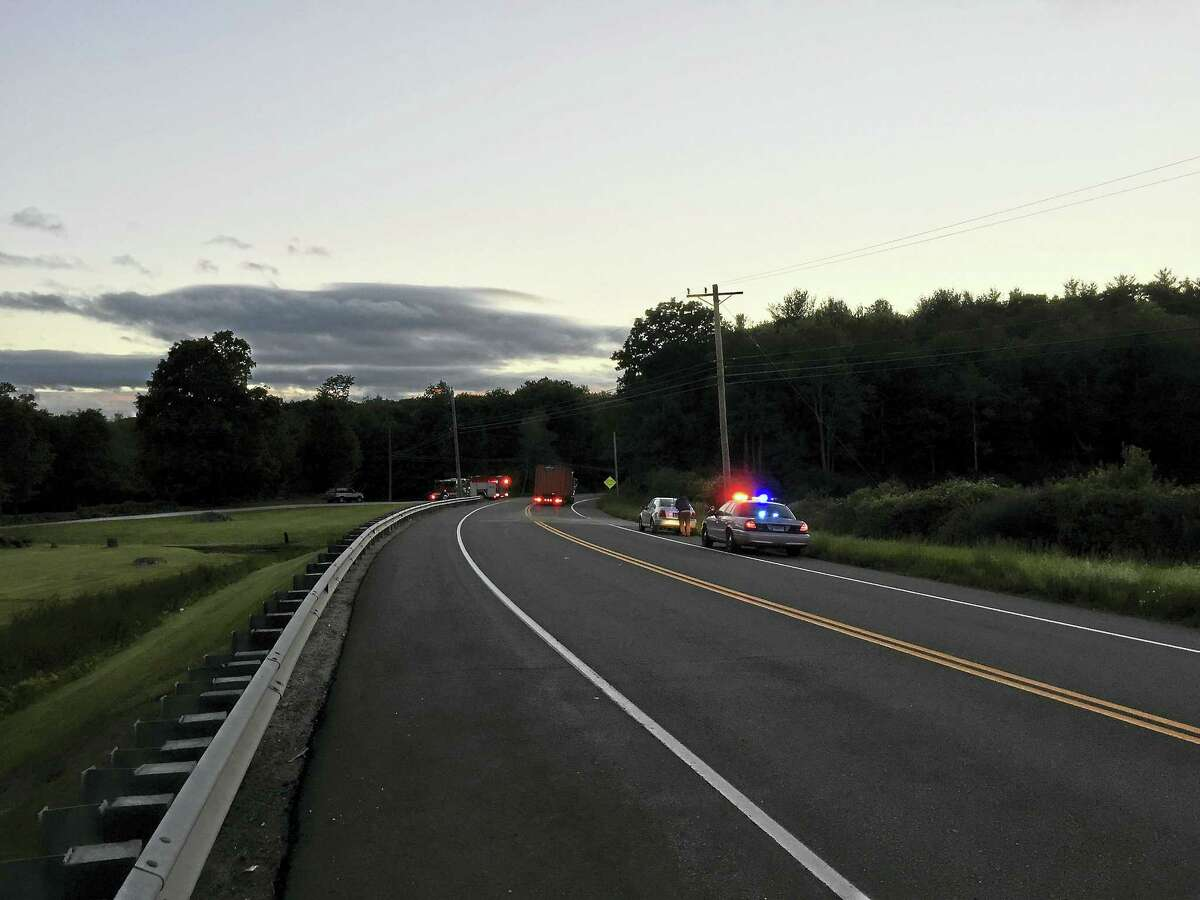 Emergency vehicles near the intersection of Route 44 and Tim O'Connor Road in Norfolk Monday.
