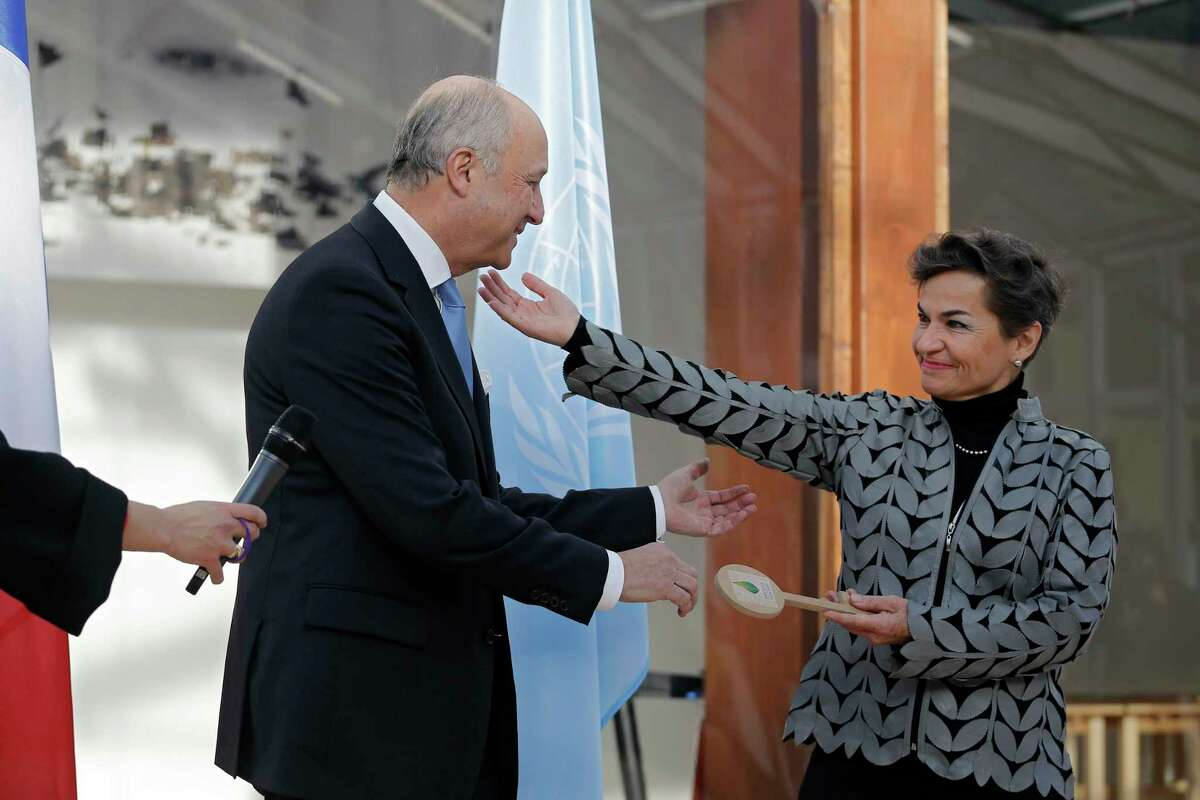 French Foreign Minister Laurent Fabius hands over the keys of Le Bourget to United Nations climate chief Christiana Figueres, right, at the venue of the U.N Climate Conference in Le Bourget, outside Paris, Saturday Nov. 28, 2015. The site of Paris-Le Bourget will officially become United Nations territory for the COP 21 conference where more than 100 heads of state are expected to attend and is scheduled to start on Nov. 30.
