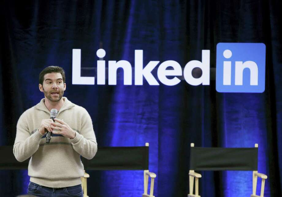 """In this Nov. 6, 2014 photo, LinkedIn CEO Jeff Weiner speaks during the company's second annual """"Bring In Your Parents Day,"""" at LinkedIn headquarters in Mountain View, Calif. Photo: AP Photo/Marcio Jose Sanchez, File  / AP"""