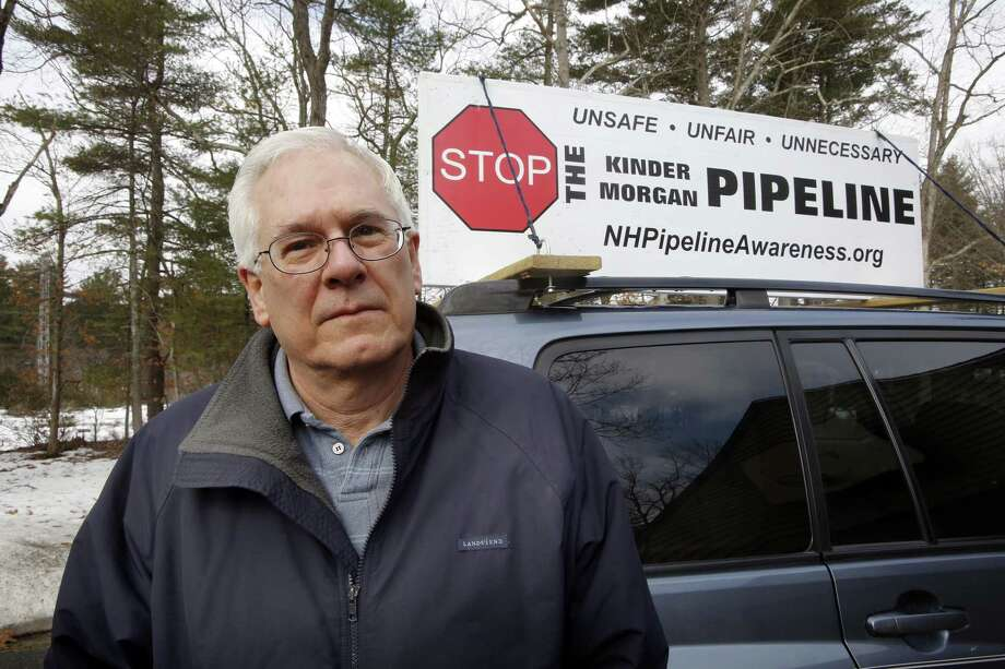 In this, March 26, 2015 photo, Homer Shannon poses at his home in Windham, N.H. The retired high-tech salesman is part of a 10-family group of neighbors opposed to a planned natural gas pipeline the would run right by his property behind him. Photo: AP Photo/Jim Cole  / AP