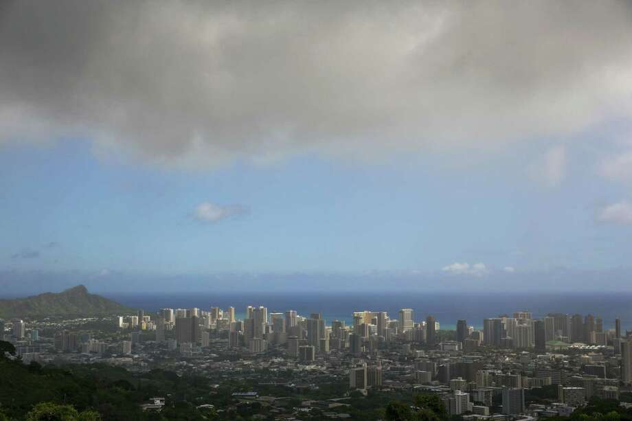 In this Aug. 7, 2014 file photo, clouds hang over Honolulu as Hurricane Iselle approaches. The National Oceanic and Atmospheric Administration's Central Pacific Hurricane Center says the 2015 hurricane season in the region will see more storms than average from June 1 through Nov. 30. Photo: Associated Press  / FR132415 AP