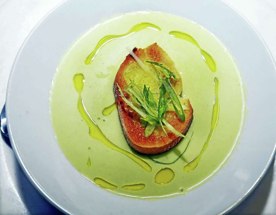 Head chef Mario Gonzalez's green grape gazpacho soup at Bistro Mediterranean & Tapas Bar in East Haven. Photo: Catherine Avalone — Register  / New Haven RegisterThe Middletown Press
