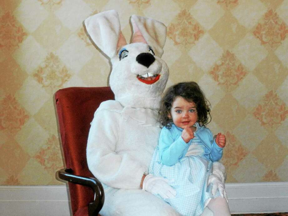Molly Conway, 2, with the Easter Bunny at Torrington Elk's Club's Breakfast with the Easter Bunny on Sunday. Photo: Stephen Underwood — Special To The Register Citizen
