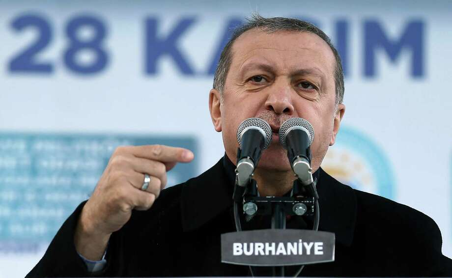 """Turkey's President Recep Tayyip Erdogan addresses a rally in Burhaniye, Turkey, Saturday, Nov. 28, 2015. Erdogan on Saturday voiced regret over Turkey's downing of a Russian warplane, saying his country was """"truly saddened"""" by the incident and wished it hadn't occurred. It was the first expression of regret by the strongman leader since Tuesday's incident in which Turkish F-16 jets shot down the Russian jet on grounds that it had violated Turkey's airspace despite repeated warnings to change course. Photo: AP Photo/Yasin Bulbul, Presidential Press Service, Pool / Pool Presidential Press Service"""