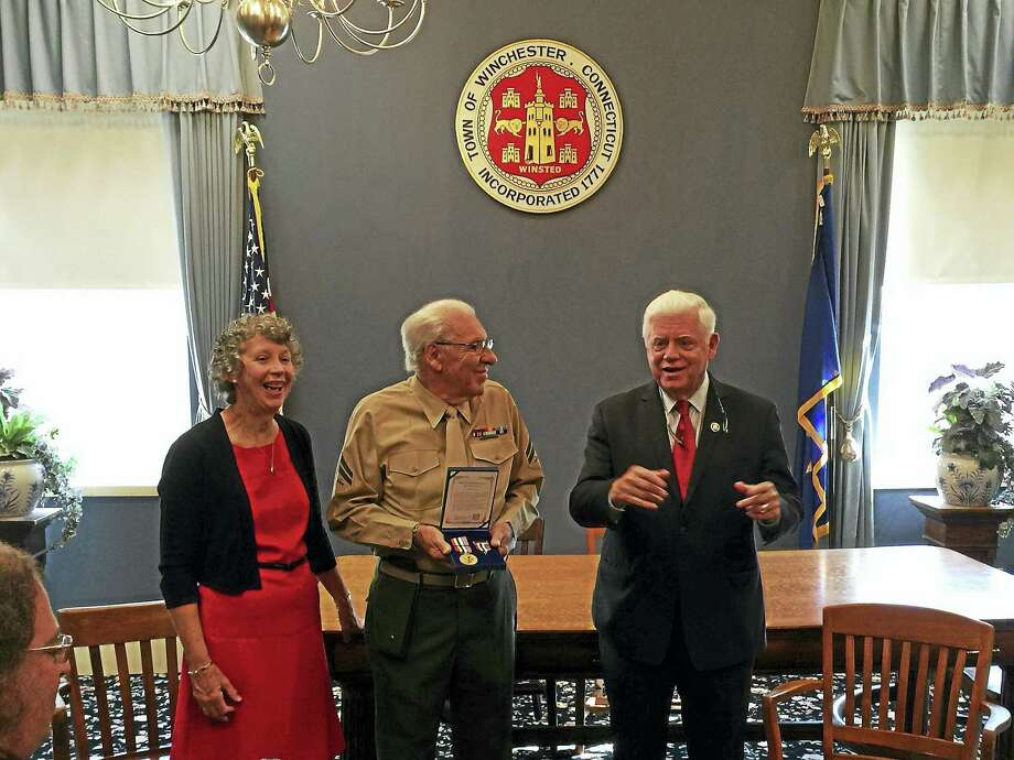 Ben Lambert - The Register Citizen  U.S. Marine Anthony Zacchio received the Korean Ambassador for Peace Medal Tuesday morning from U.S. Rep. John Larson Tuesday morning in Winsted. Photo: Digital First Media