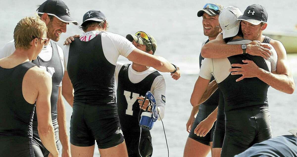 Yale first varsity rowers celebrate on the Yale Boathouse dock in Ledyard after the 151st Harvard-Yale Regatta on Sunday.