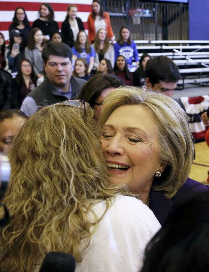 Democratic presidential candidate Hillary Clinton hugs a supporter at a campaign event, Tuesday, Feb. 2, 2016, in Nashua, N.H. Photo: AP Photo/Elise Amendola   / AP
