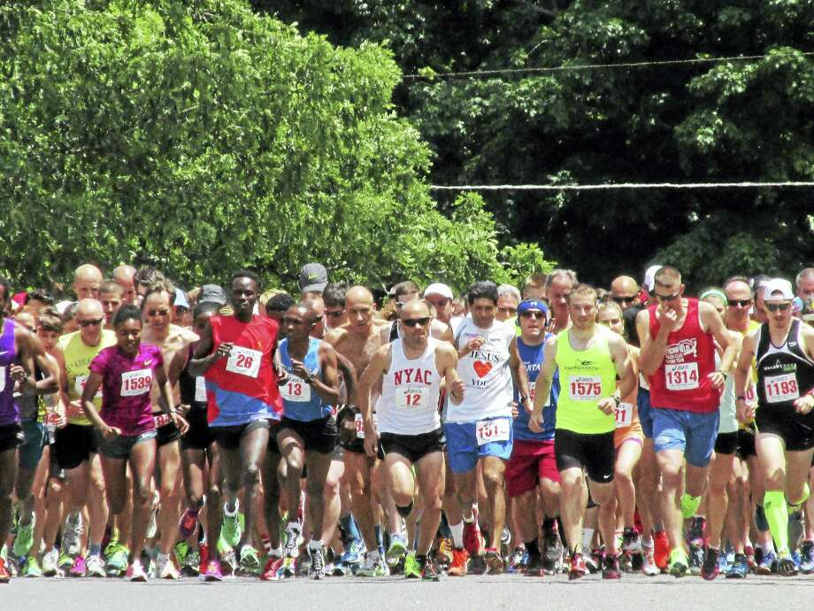 More than 1,400 runners took off at the sound of the cannon for the 40th Litchfield Hills Road Race on Sunday, starting and finishing at the Litchfield community green. Photo: Photo By Peter Wallace