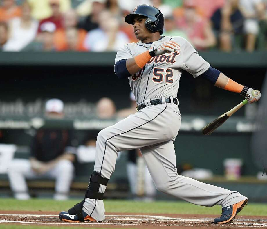 Yoenis Cespedes, following through on a single against the Baltimore Orioles Thursday, has been traded to the New York Mets. Photo: Gail Burton — The Associated Press  / FR4095 AP
