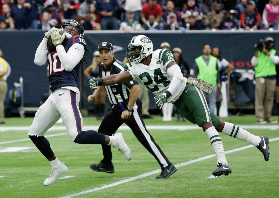 Texans receiver DeAndre Hopkins burns Jets cornerback Darrelle Revis for a touchdown on Sunday in Houston. Photo: David J. Phillip — The Associated Press  / AP