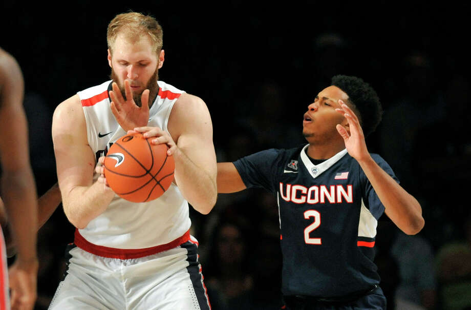 UConn guard Jalen Adams gets his arm caught under Gonzaga center Przemek Karnowski during the Huskies' 73-70 loss on Friday in the Battle 4 Atlantis in the Bahamas. Photo: Brad Horrigan — The Associated Press  / Hartford Courant