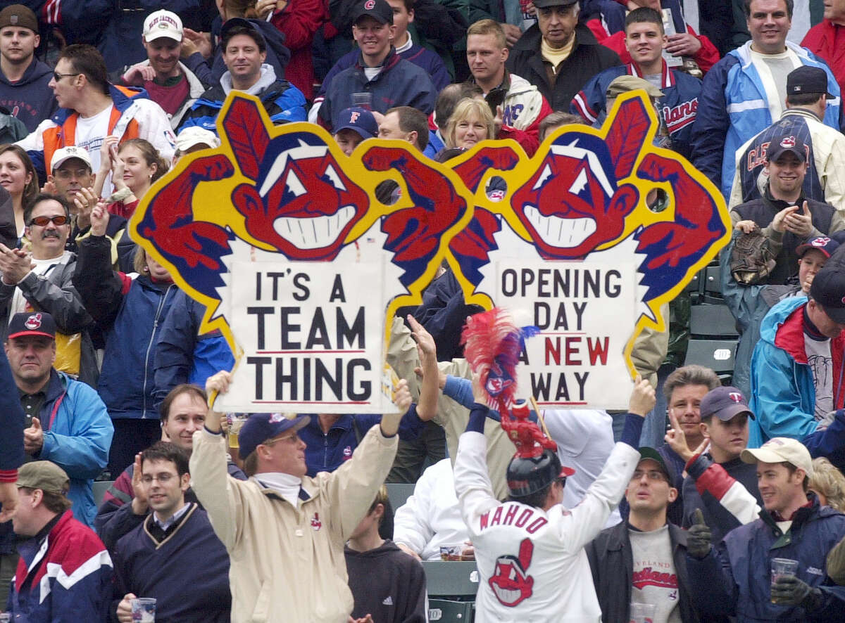 In this 2002 file photo, fans hold up Chief Wahoo signs as they celebrate an Indians' win.