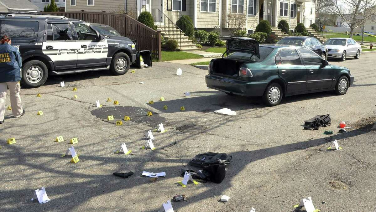 This undated forensics photograph made by the FBI, released Tuesday, March 24, 2015, by the U.S. Attorney's office and presented as evidence during the federal death penalty trial of Dzhokhar Tsarnaev in Boston, shows the scene of the April 19, 2013, gun battle in Watertown, Mass., between police and Dzhokhar and Tamerlan Tsarnaev. Dzhokhar Tsarnaev is charged with conspiring with his brother to place two bombs near the Boston Marathon finish line that killed three and injured more than 260 spectators in April 2013. Tamerlan died after he was wounded during the gun battle and run over by Dzhokhar as he escaped. (AP Photo/U.S. Attorney's Office)