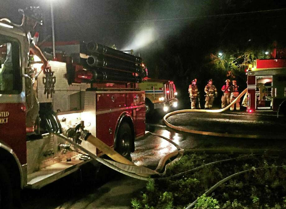 Eleven different emergency departments were dispatched to a fire at 118 Old New Hartford Road, Barkhamsted, on Thursday evening. Photo: Contributed Photo