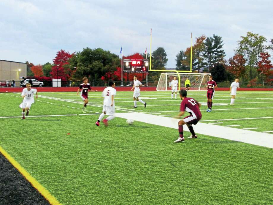 The field was in constant motion in Torrington's fast-paced game against Naugatuck Monday evening at the Robert H. Frost Sports Complex. Photo: Photo By Peter Wallace