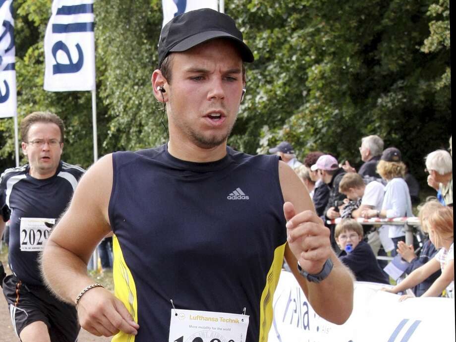 In this Sunday, Sept. 13, 2009 photo Andreas Lubitz competes at the Airportrun in Hamburg, northern Germany. Germanwings co-pilot Andreas Lubitz appears to have hidden evidence of an illness from his employers, including having been excused by a doctor from work the day he crashed a passenger plane into a mountain, prosecutors said Friday, March 27, 2015.  The evidence came from the search of Lubitz's homes in two German cities for an explanation of why he crashed the Airbus A320 into the French Alps, killing all 150 people on board. (AP Photo/Michael Mueller) Photo: AP / MULMM