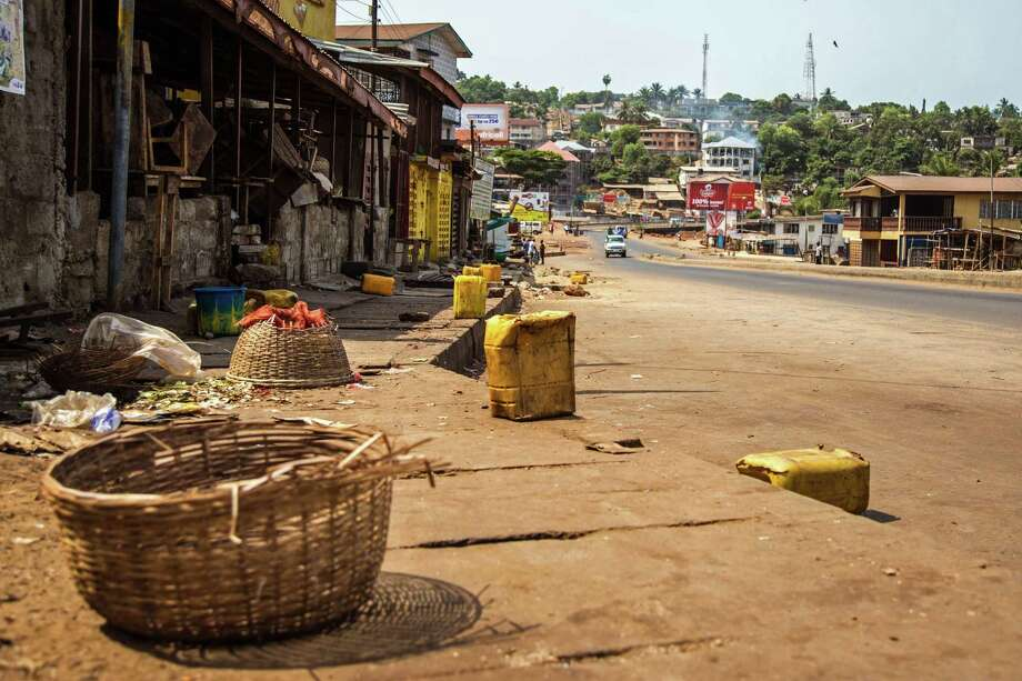 A usually busy street is deserted as Sierra Leone enters the second day of a three day country wide lockdown on movement of people due to the Ebola virus in the city of Freetown, Sierra Leone, Saturday, March 28,  2015. Guinea has deployed security forces to the country's southwest in response to reports that Sierra Leoneans are crossing the border to flee an Ebola lockdown intended to stamp out the deadly disease, an official said Saturday. (AP Photo/ Michael Duff) Photo: AP / AP