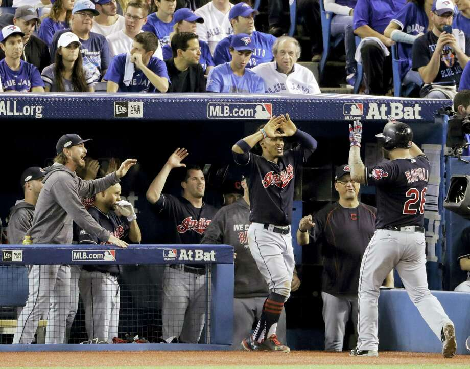 The Indians' Mike Napoli, right, celebrates with teammates after his home run during the fourth inning on Monday. Photo: Charlie Riedel — The Associated Press  / Copyright 2016 The Associated Press. All rights reserved.