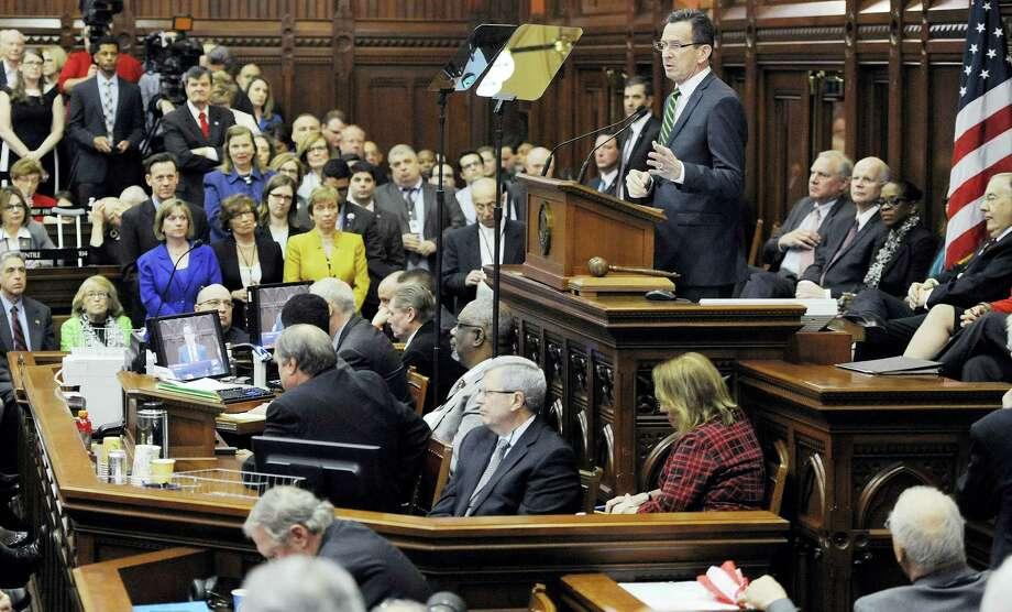 In this Feb. 3 file photo, Gov. Dannel P. Malloy delivers his budget address to the Senate and House inside the Hall of the House at the State Capitol in Hartford. Photo: JESSICA HILL — ASSOCIATED PRESS  / FR125654 AP