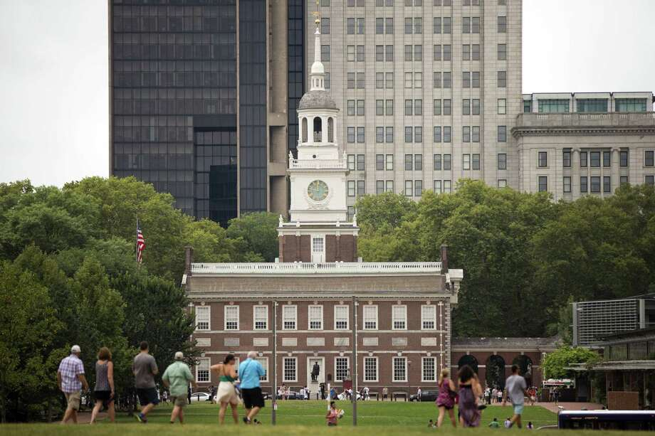 Tourists walk in view of Independence Hall in Philadelphia. Pope Francis is scheduled to speak on religious freedom and immigration in the shadow of Independence Hall during his visit to the United States. Photo: AP Photo/Matt Rourke / AP
