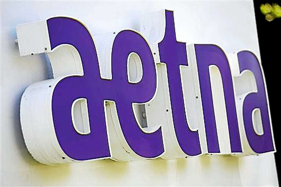 This Aug. 19, 2014 photo, shows signage in front of Aetna Inc.'s headquarters in in Hartford, Conn. Photo: AP Photo/Jessica Hill, File