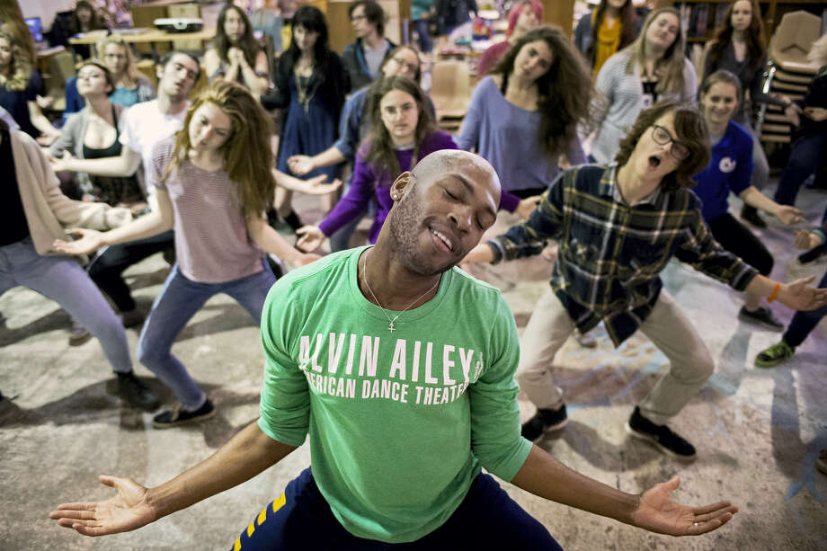 In this April 7, 2015 photo, dancer Antonio Douthit, front, of the Alvin Ailey American Dance Theater teaches a group of high school students a sampling of modern dance choreography during class at the site of the Lincoln Public Schools Arts and Humanities Focus Program, in Lincoln, Neb. Photo: Kristin Streff/The Journal-Star Via AP  / The Journal-Star