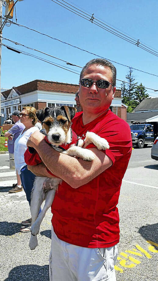 N.F. Ambery photo Jay Kaine of Torrington and his nine-month-old Jack Russell Terrier Tucker watched Kaine's daughter Jordan race. Photo: Journal Register Co.