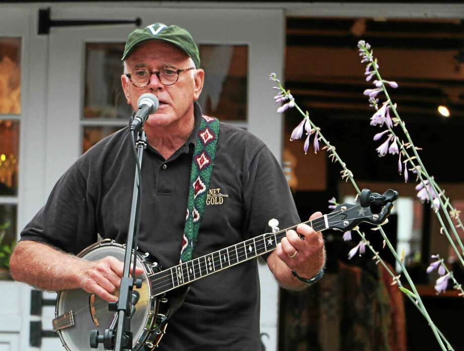 Mike Delay of Western Lands Trio performs in Litchfield Thursday evening. Photo: John Fitts — The Register Citizen