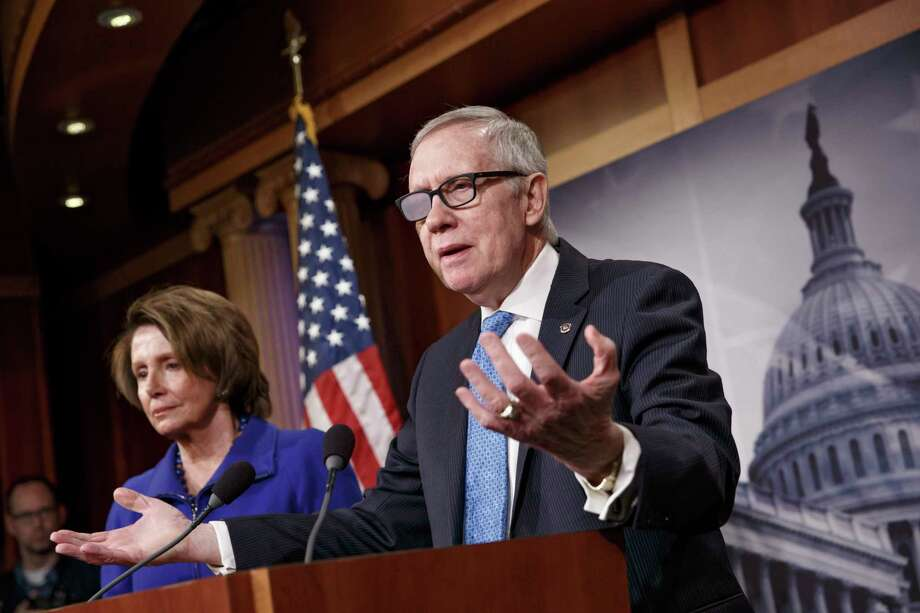 In this Feb. 26 file photo, Senate Minority Leader Harry Reid of Nevada, accompanied by House Minority Leader Nancy Pelosi of California, gestures during a news conference on Capitol Hill in Washington. Photo: AP Photo  / AP