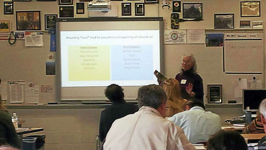 Kay Carroll speaks to attendees of the Farmers Forum at Wamogo Regonal High School in Litchfield Saturday on the feasibility of a food hub for Northwest Connecticut. Photo: Catherine Guarnieri — Register Citizen