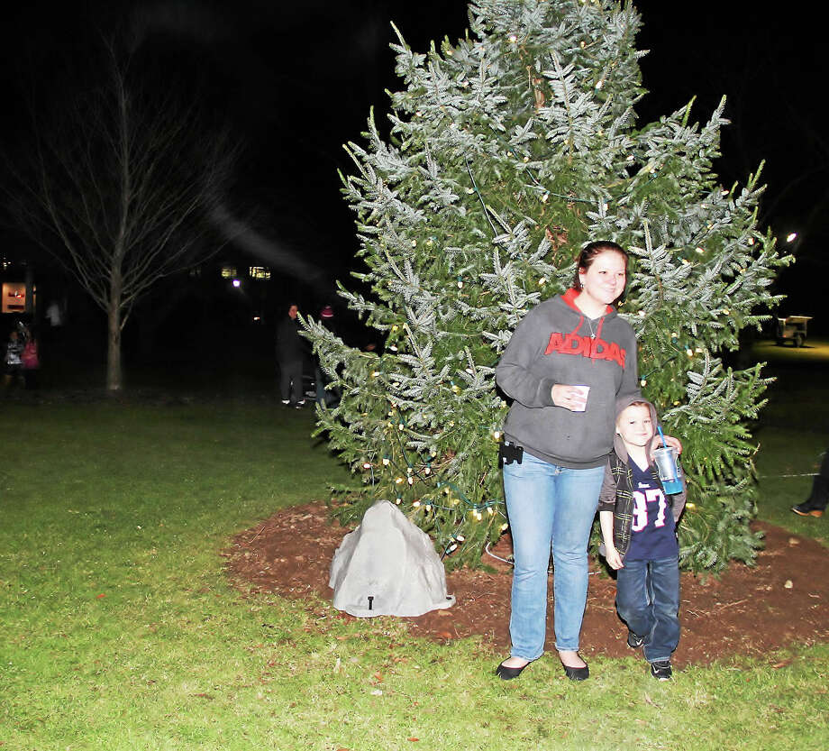 Ashley Chausse of Torrington and her son, Joseph Bessette, 6, at Coe Memorial Park in Torrington for the annual tree lighting event Friday evening. Photo: Manon Mirabelli — Register Citizen