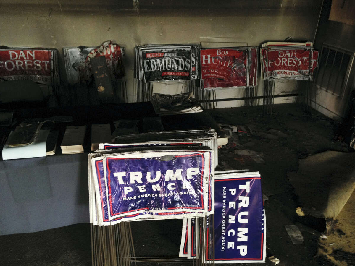 """Melted campaign signs are seen at the Orange County Republican Headquarters in Hillsborough, NC on Oct. 16, 2016. Someone threw flammable liquid inside a bottle through a window overnight and someone spray-painted an anti-GOP slogan referring to """"Nazi Republicans"""" on a nearby wall, authorities said Sunday. State GOP director Dallas Woodhouse said no one was injured."""