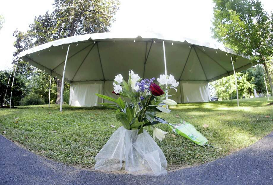 Flowers are the only markers at the grave of boxing great Muhammad Ali Saturday in Louisville, Ky. Photo: Mark Humphrey — The Associated Press  / Copyright 2016 The Associated Press. All rights reserved. This material may not be published, broadcast, rewritten or redistribu
