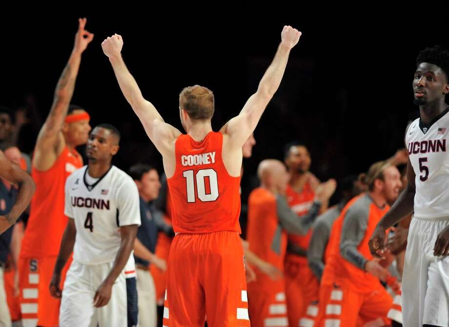 Syracuse guard Trevor Cooney (10) celebrates at the end of the Orange's 79-76 win over UConn in the semifinals of the Battle 4 Atlantis on Thursday in the Bahamas. Photo: Brad Horrigan — The Associated Press  / The Courant
