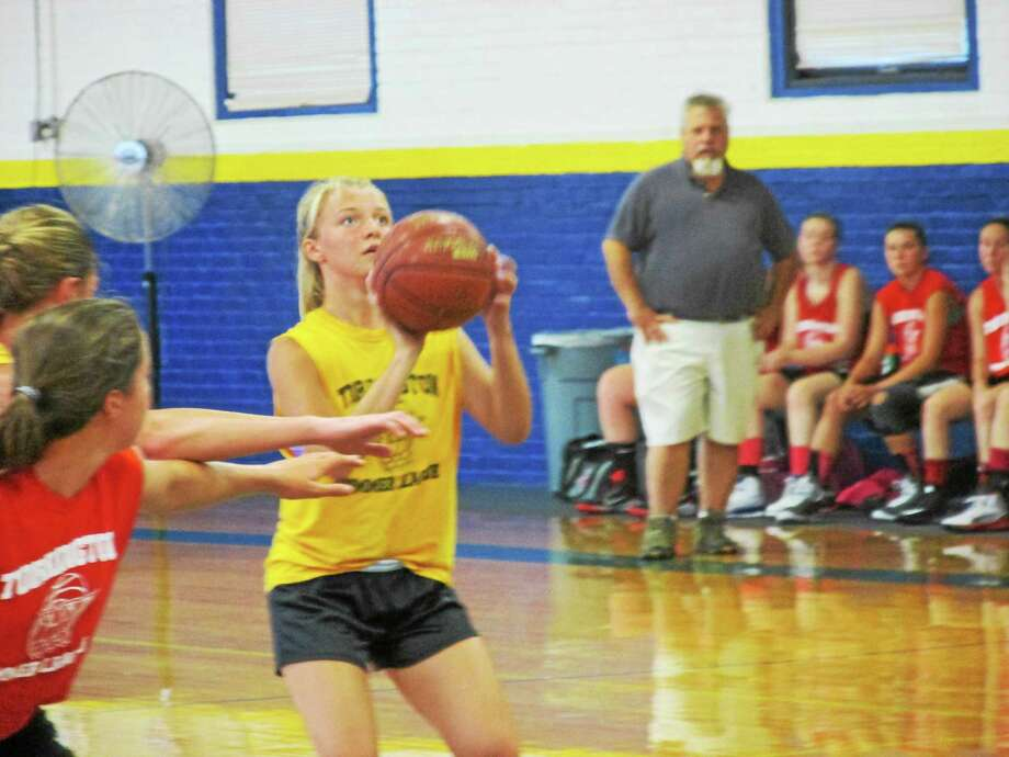 Incoming Housatonic freshman Caroline Hurlburt is one of the many soon-to-be-varsity players getting a jump start on playing with members of their high school teams in the Torrington Summer Basketball League. Photo: Peter Wallace —The Register Citizen