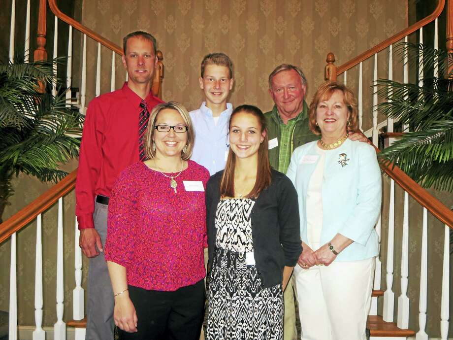 Contributed photo Michaela Cisowski, front right, was recently named the recipient of the Litchfield County Board of REALTORSÆ 2016 TJ Zappulla scholarship. She is pictured with her family and members of the LCBR. Photo: Journal Register Co.