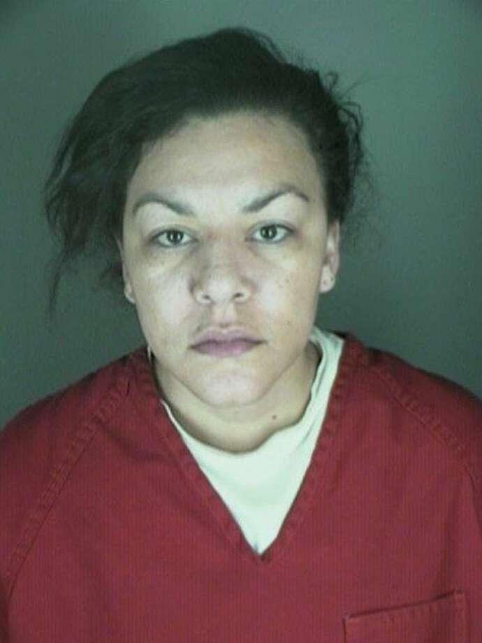 FILE - In this undated file photo, provided by the Longmont Police Department shows Dynel Lane, 34, who is accused of stabbing a pregnant woman in the stomach and removing her baby, while the expectant mother visited her home to buy baby clothes advertised on Craigslist authorities said. Catherine Olguin, a spokeswoman for the Boulder County District Attorney's Office, said Thursday, March 26, 2015, that Lane will not be charged with murder in the baby's death. (AP Photo/ Longmont Police Department, File) Photo: AP / Longmont Police Department