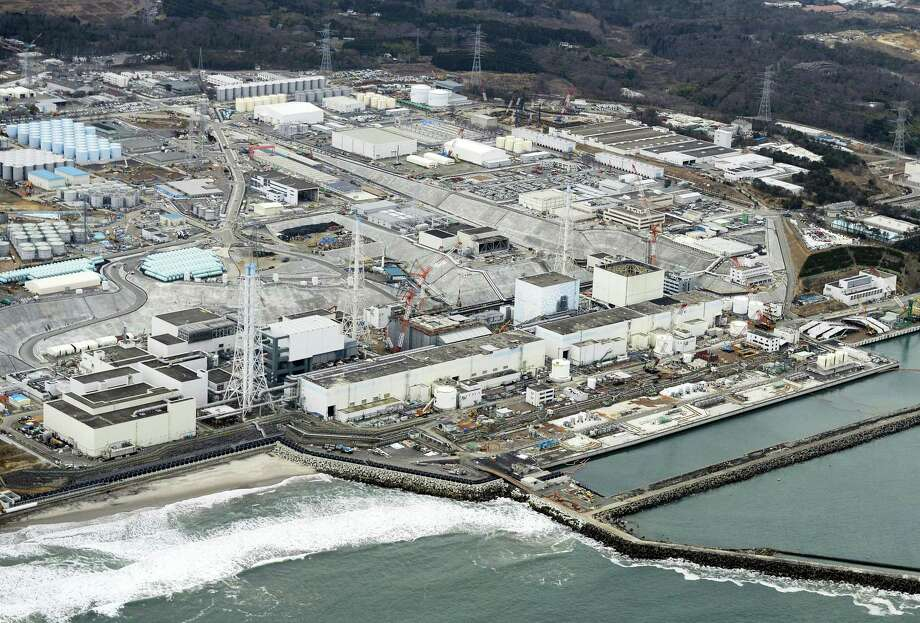 This March 11, 2016, photo shows the crippled Fukushima Dai-ichi nuclear plant in Okuma town, Fukushima prefecture, northeastern Japan. The operator of Japan's destroyed Fukushima nuclear plant switched on a giant refrigeration system on Thursday, March 31, to create an unprecedented underground ice wall around its damaged reactors. Radioactive water has been flowing from the reactors, and other methods have failed to fully control it. The decontamination and decommissioning of the plant, damaged by a massive earthquake and tsunami in 2011, hinge of the success of the wall. Photo: Kyodo News Via AP   / Kyodo News