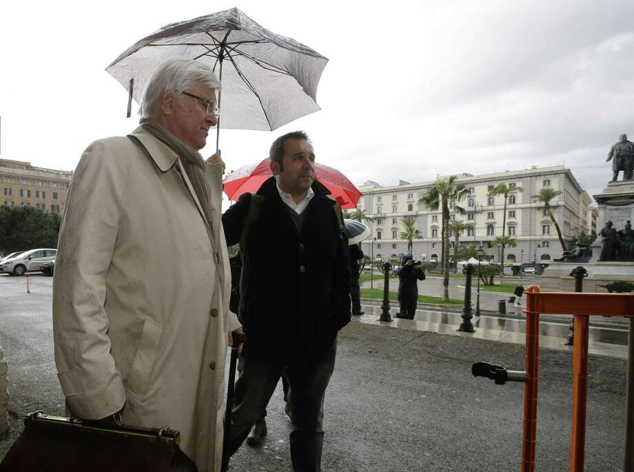 Amanda Knox's lawyer Luciano Ghirga, left, arrives at Italy's highest court building, in Rome, Friday, March 27, 2015. American Amanda Knox and her Italian ex-boyfriend Raffaele Sollecito expect to learn their fate Friday when Italy's highest court hears their appeal of their guilty verdicts in the brutal 2007 murder of Knox's British roommate Meredith Kercher. (AP Photo/Alessandra Tarantino) Photo: AP / AP